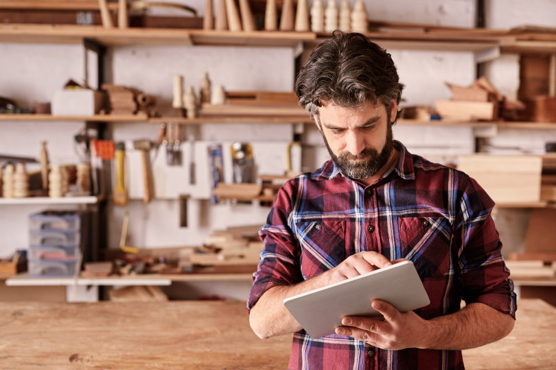 Craftman using a tablet PC