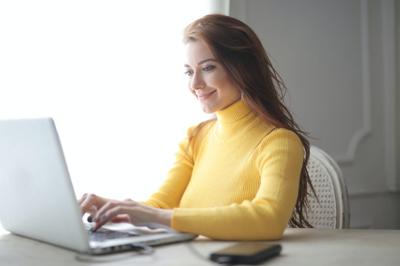 Businesswoman running a business with a laptop