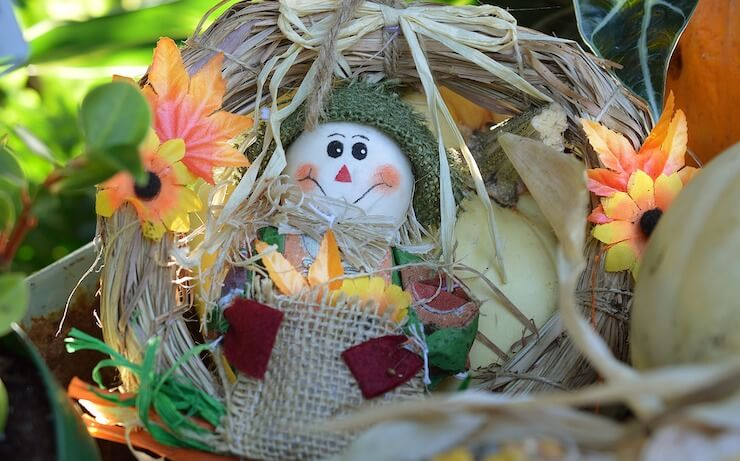 Fall hay wreath with scarecrow and orange yellow flowers